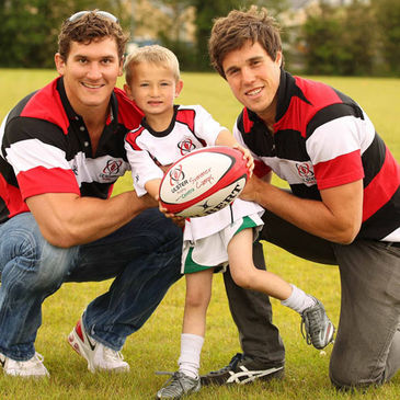 Robbie Diack and Adam D'Arcy with a young camp participant