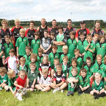 Members of the Ulster squad with young players and fans at City of Derry RFC