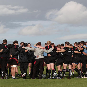 The Ulster players and management huddle together