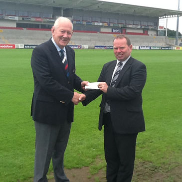 The Charitable Trust's John Callaghan receives the cheque