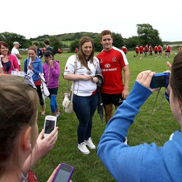 Paddy Jackson poses for a photograph with an Ulster fan