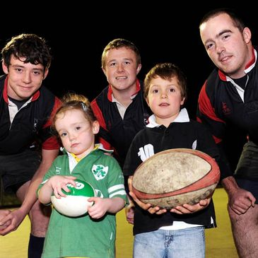Members of Unidare RFC with two young fans