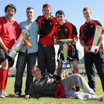 The Unidare RFC players with Leinster's three trophies