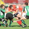 The Scarlets' Vernon Cooper is stopped in his tracks by Connacht pair Michael Swift and Ian Keatley