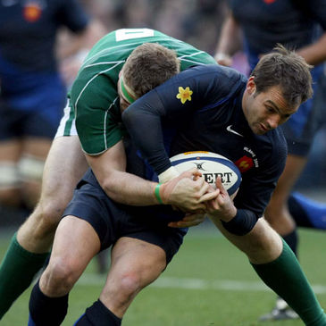 French winger Vincent Clerc is tackled by Jamie Heaslip