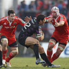 Ospreys centre James Hook is isolated as Munster back rowers David Wallace and Denis Leamy close in on him