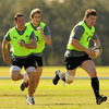 Ireland captain Brian O'Driscoll takes the ball on, with Ulster duo Paddy Wallace and Andrew Trimble in support