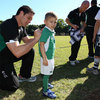 A young Ireland fan patiently waits as back rower David Wallace signs the back of his jersey