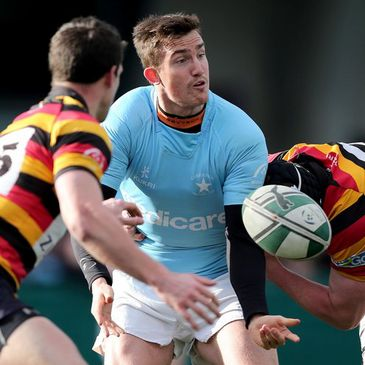 Garryowen's Matth Jarvis gets his pass away