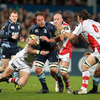 Xavier Rush, who was a previous target for Ulster, is challenged by Bryan Young and Tim Barker