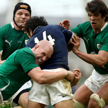 Paul O'Connell and Donncha O'Callaghan tackle France's Yoann Huget