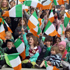 Young schoolkids from the local region cheered the players and waved Irish flags as part of the welcome ceremony in Queenstown