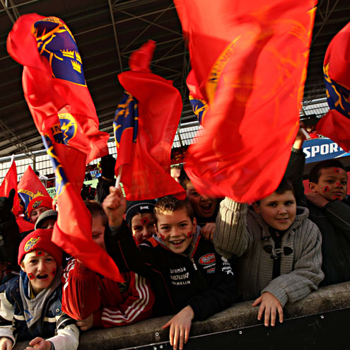 Young fans wave their Munster flags at Thomond Park