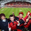 Some of Munster's younger fans show their delight at being in the redeveloped Thomond Park Stadium