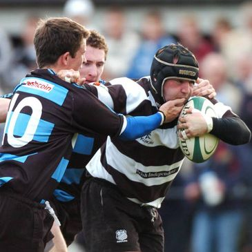 Old Belvedere's Richie Murphy is tackled by Tadhg Bennett of Shannon
