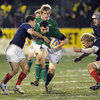 Talented number 8 Patrick Butler tries to lead an attack during Ireland's narrow loss to France in snowy Mazamet