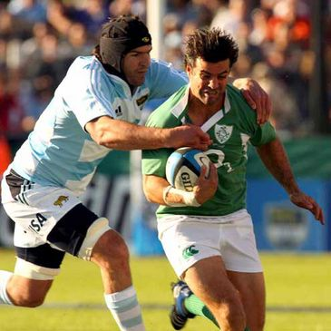 Brian Carney is tackled by Argentina's Esteban Lozada