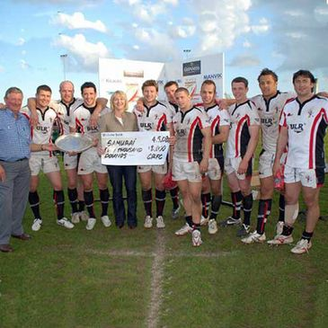 Members of the Samurai International team celebrate with the Simms Salver and their prize money