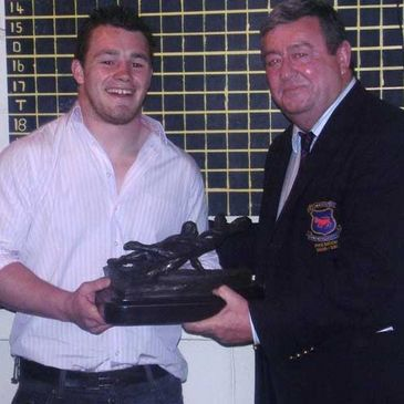 Cian Healy with Clontarf President Paul McLaughlin