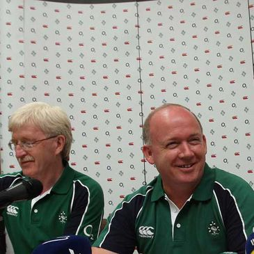 A smiling Declan Kidney is flanked by Paul McNaughton
