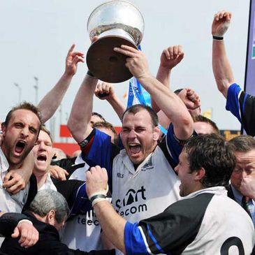 Merle O'Connell and his Cork Con side celebrate with the league trophy