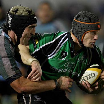 Connacht centre Mel Deane is tackled by Glasgow's Kelly Brown