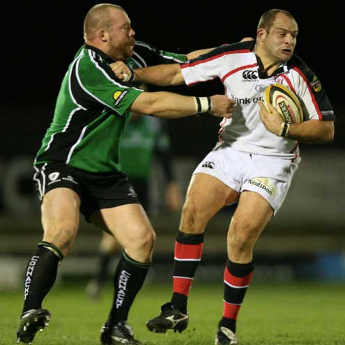 Connacht's Robbie Morris tries to stop Ulster captain Rory Best
