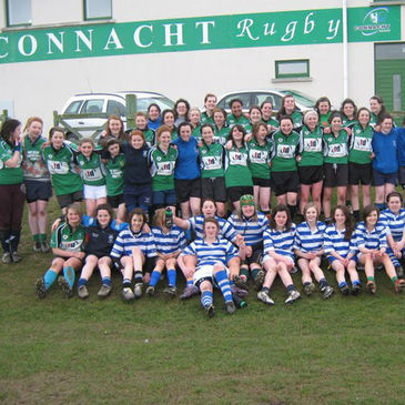 Members of the Connacht Girls team and the Munster Barbarians