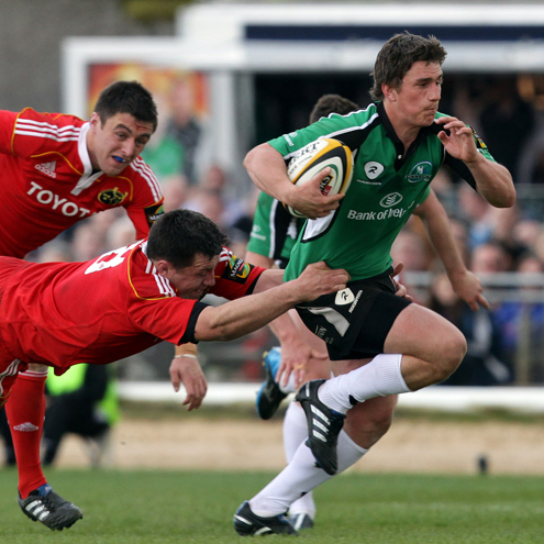 Ian Keatley tries to evade James Coughlan