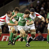 Gordon D'Arcy makes a typical break through the English back line