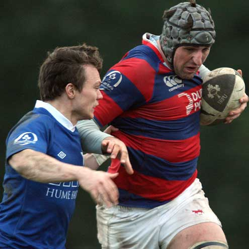 St. Mary's scrum half Matt D'Arcy challenges Clontarf's Conor O'Keefe