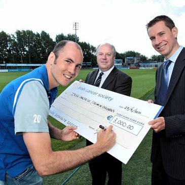 Girvan Dempsey makes a donation