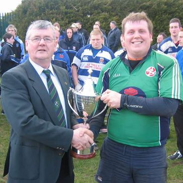 John O'Loan presenting the trophy to Limerick IT captain Alan Guiry