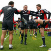 Wuan du Preez, Denis Fogarty and Ronan O'Gara share a joke as the Munster players go through their warm-up