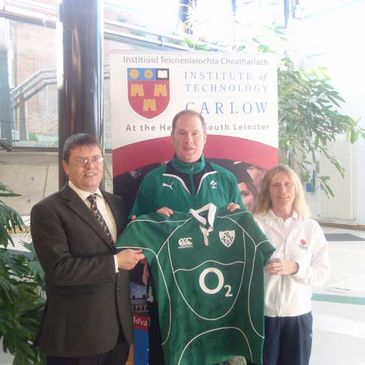 Des Ryan presents a signed Ireland jersey to IT Carlow