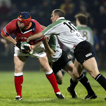 Eric Elwood tackles Anthony Foley during the 2002 Celtic League quarter-final