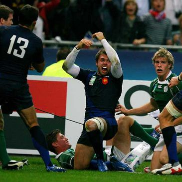 Vincent Clerc celebrates a try against Ireland during the World Cup
