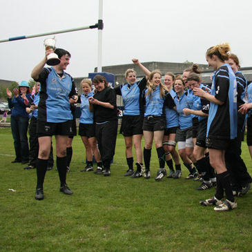 The Galwegians players celebrate their Paul Flood Cup final win