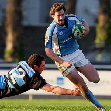 Garryowen winger Ciaran O'Boyle avoids a tackle from Shannon's John Clogan