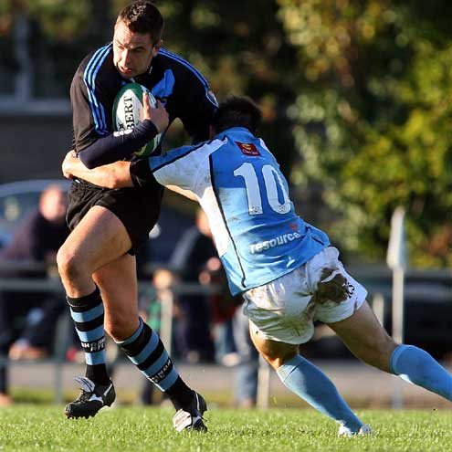 Shannon's Munster flanker Niall Ronan is tackled by Garryowen's Conan Doyle