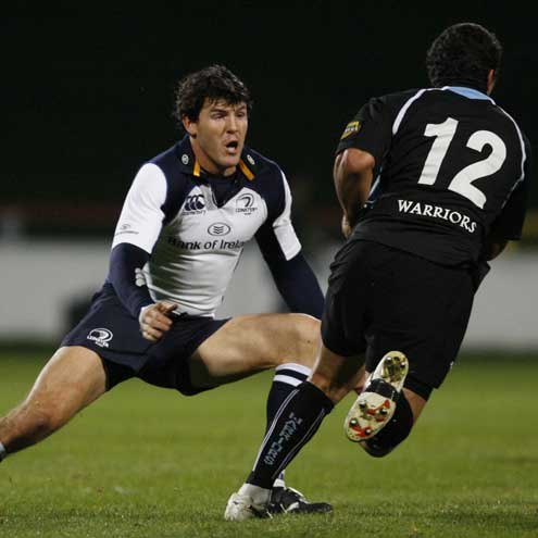 Leinster's Shane Horgan prepares to tackle Daryl Gibson of Glasgow