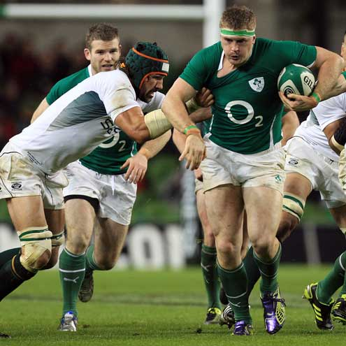 Jamie Heaslip battles past Victor Matfield