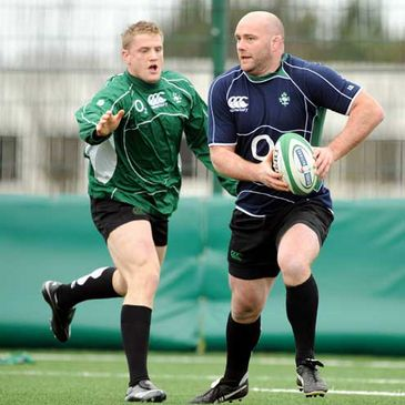 Jamie Heaslip challenges John Hayes during an Ireland training session at UCD