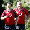 Munster and Ireland duo Marcus Horan and John Hayes do some light jogging in the Belfast sunshine