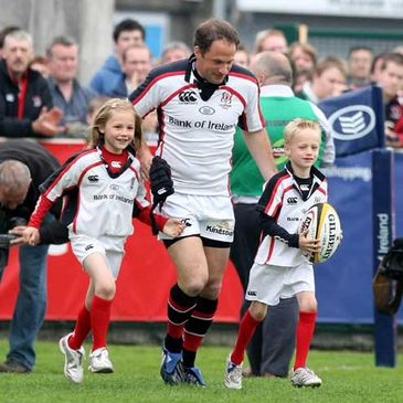David Humphreys running out at Ravenhill with his daughter Katie and son James