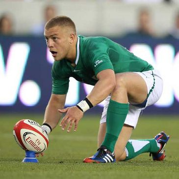 Ian Madigan lines up a kick against USA