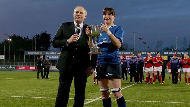 Leinster Women's captain Carmela Morey is presented with the trophy by Philip Orr