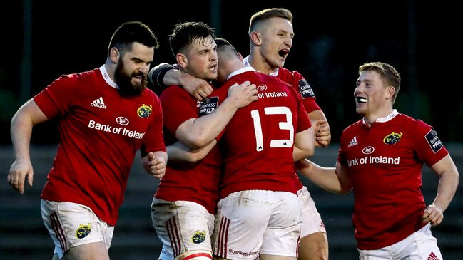 Try scorer Conor Oliver is congratulated by his Munster 'A' team-mates