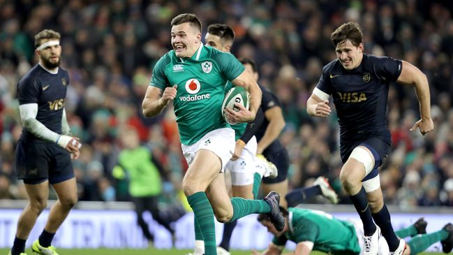 Jacob Stockdale runs in his first try against Argentina