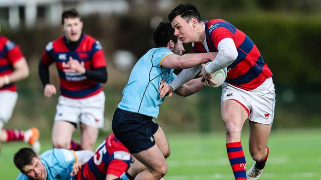 Clontarf's Matt D'Arcy takes on the UCD defence